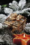 Christmas decoration, candle and ornamental parcel Stock Photography
