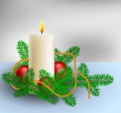 Christmas decoration with candle and pine branches. Christmas decoration with burning candle, red Christmas balls and pine branches Stock Photos