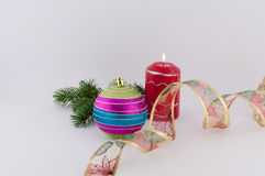 Christmas Decoration. With candle, ribbon and ball on a white background royalty free stock image