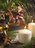 Christmas Decoration with candle and Santa Claus Royalty Free Stock Images