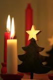 Christmas decoration and candles. Wooden Christmas tree ornament and candles - shallow depth of field Royalty Free Stock Photos