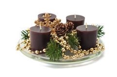Christmas decoration with candles. Pine cones, spruce branches Stock Image
