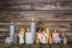 Christmas decoration with candles and angels on wooden backgroun Stock Photography