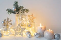 Christmas decoration with candles on background  white wall. The Christmas decoration with candles on background  white wall Stock Image