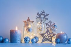 Christmas decoration with candles on background  white wall. The Christmas decoration with candles on background  white wall Stock Images