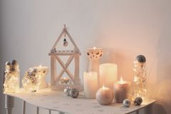 Christmas decoration with candles on background  white wall. The Christmas decoration with candles on background  white wall Royalty Free Stock Photos