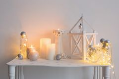 Christmas decoration with candles on background  white wall. The Christmas decoration with candles on background  white wall Royalty Free Stock Images