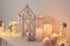 Christmas decoration with candles on background white wall royalty free stock images