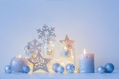 Christmas decoration with candles on background  white wall. The Christmas decoration with candles on background  white wall Stock Photography