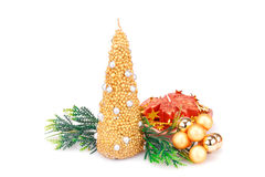 Christmas decoration. Christmas candles, balls and  fir tree branches  isolated on white background Stock Photos