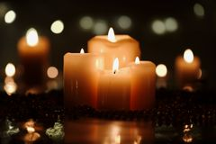 Christmas decoration with candles and beads. Christmas decoration with four candles in foreground and defocused candles in background Stock Photos