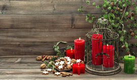 Christmas decoration with candles, cookies and pine branch Royalty Free Stock Photography