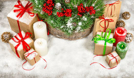 Christmas decoration with candles and gift boxes Royalty Free Stock Images