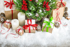 Christmas decoration with candles, gift boxes and snow Royalty Free Stock Images