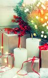 Christmas decoration candles gifts vintage toned. Christmas decoration with candles and gifts. Vintage style toned picture stock photography