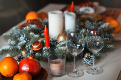 Christmas decoration with candles and glasses Royalty Free Stock Image
