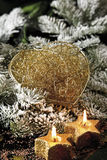 Christmas  decoration, candles and heart-shaped ornamental parcel Stock Photos