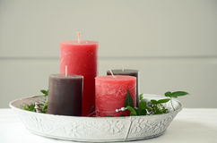 Christmas decoration with candles and ivy Stock Photos