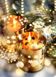 Christmas decoration with candles, lanterns and golden lights Royalty Free Stock Photos