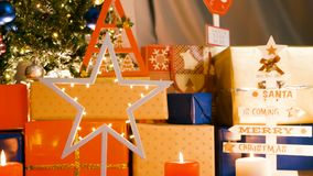 Christmas decoration, candles and pine tree with garlands. In Christmas eve stock footage