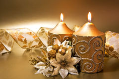 Christmas decoration with candles and ribbon Stock Image