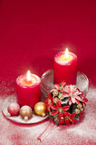 Christmas decoration with candles ribbons and cookies Stock Photo