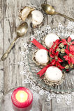 Christmas decoration with candles ribbons and cookies Stock Photos