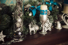 Christmas decoration - candles, snowflakes, deer, bells Stock Photo