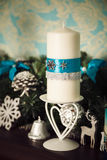 Christmas decoration - candles, snowflakes, deer, bells Royalty Free Stock Photo
