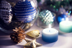 Christmas decoration and candles. Still life with candles and Christmas decorations on the table Stock Photos