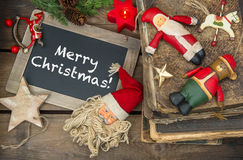 Christmas decoration candles and vintage toys. Chalkboard Stock Image