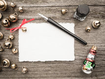 Christmas decoration, card, inkwell, quill and bells Stock Photos