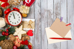 Christmas decoration, card and pen over wooden background. Winter holidays concept. Space for text. Christmas decoration, card and pen over the wooden Royalty Free Stock Photos