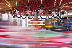 Christmas Decoration, carousel in motion blur Stock Photo
