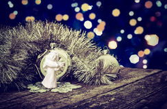 Christmas Decoration - Chain, Angel and Baubles On Old Planks. Stock Images