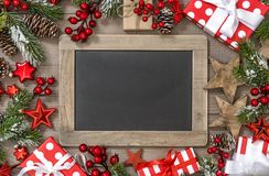 Christmas decoration chalkboard gift box stars ornaments. Christmas decoration with chalkboard, gift box, stars and ornaments royalty free stock photo