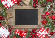 Christmas decoration chalkboard gifts ornaments. Christmas decoration with chalkboard, gifts and ornaments stock photo