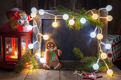 Christmas decoration with chalkboard and gingerbread man Royalty Free Stock Photography