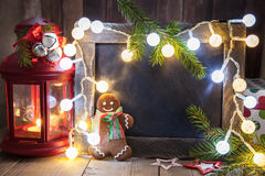 Christmas decoration with chalkboard and gingerbread man Stock Photography