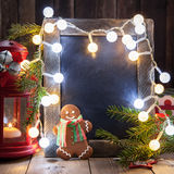 Christmas decoration with chalkboard and gingerbread man Royalty Free Stock Photos