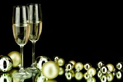 Christmas decoration and champagne on black Royalty Free Stock Image