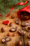 Christmas decoration with chocolate biscotti, hazelnuts and pine Stock Photography