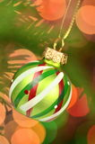 Christmas decoration, Christmas ball hanging on spruce twig Royalty Free Stock Images