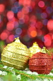 Christmas decoration, Christmas balls and cone on bokeh background Royalty Free Stock Images
