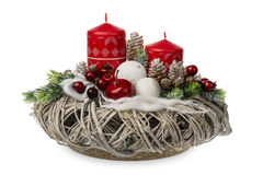 Christmas decoration - christmas composition made from wreath, candles and christmas decorative accessories isolated. Royalty Free Stock Image