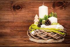 Christmas decoration - christmas composition with wreath and candles on the wooden background. Christmas decoration - composition with wreath and candles on the Stock Photography