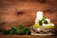 Christmas decoration - christmas composition with wreath and candles on the wooden background. Christmas decoration - composition with wreath and candles on the Royalty Free Stock Images