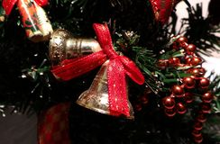 Christmas decoration. Bells and bows and beads on a Christmas tree Royalty Free Stock Photography