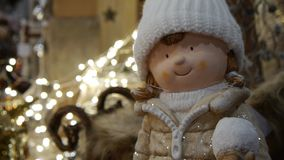 Christmas decoration with Christmas doll in the foreground stock video