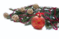 Christmas Decoration: Christmas red ball, twig of fir and beads Royalty Free Stock Photo